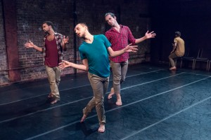 three performers dancing in a studio