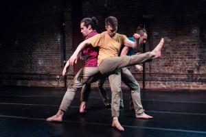 three performers dancing