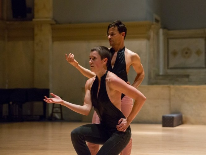 two performers in black