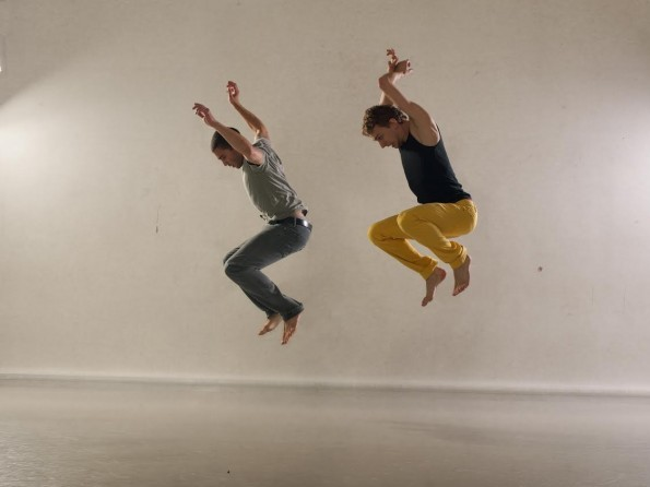 two performers jumping into the air