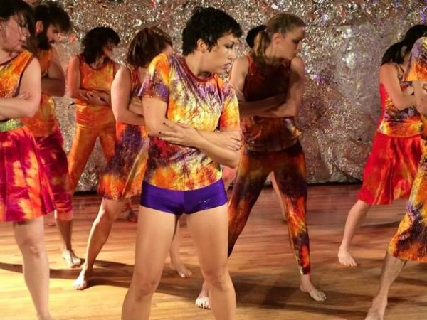 group of performers in tie-dyed clothes