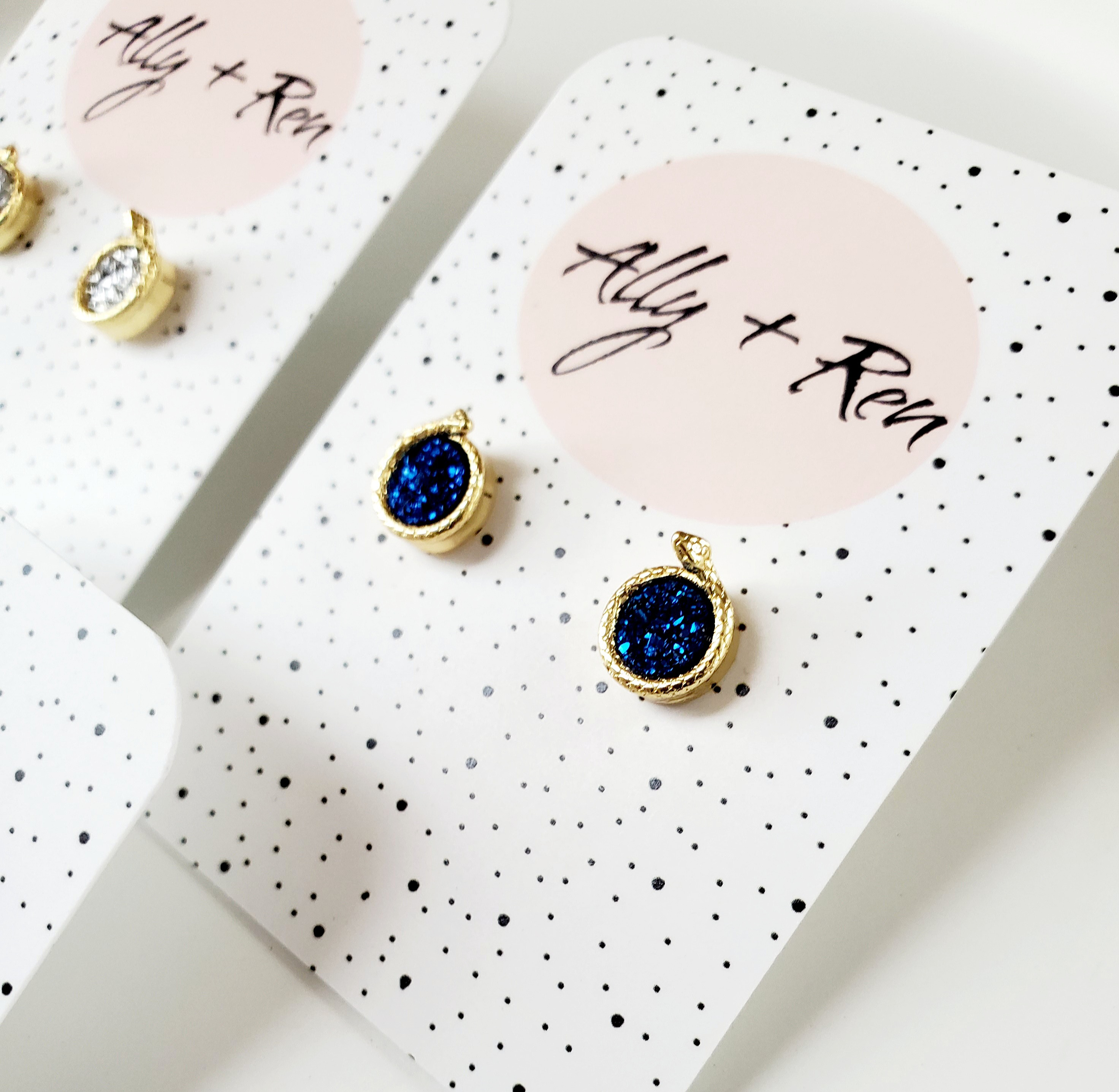 2 pairs of navy and clear crystal druzy studs