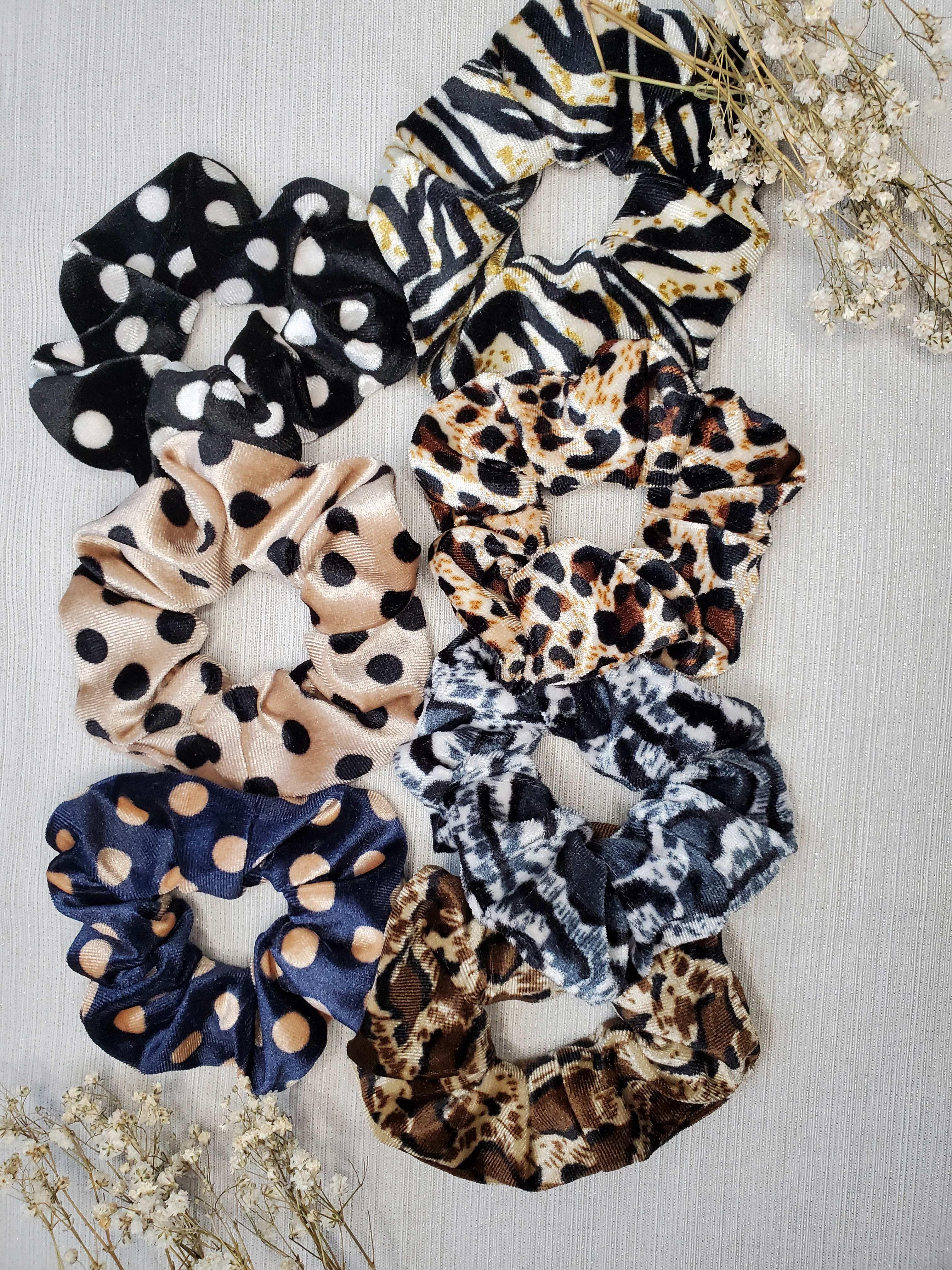 7 scrunchies (3 polka dot and 4 animal print)