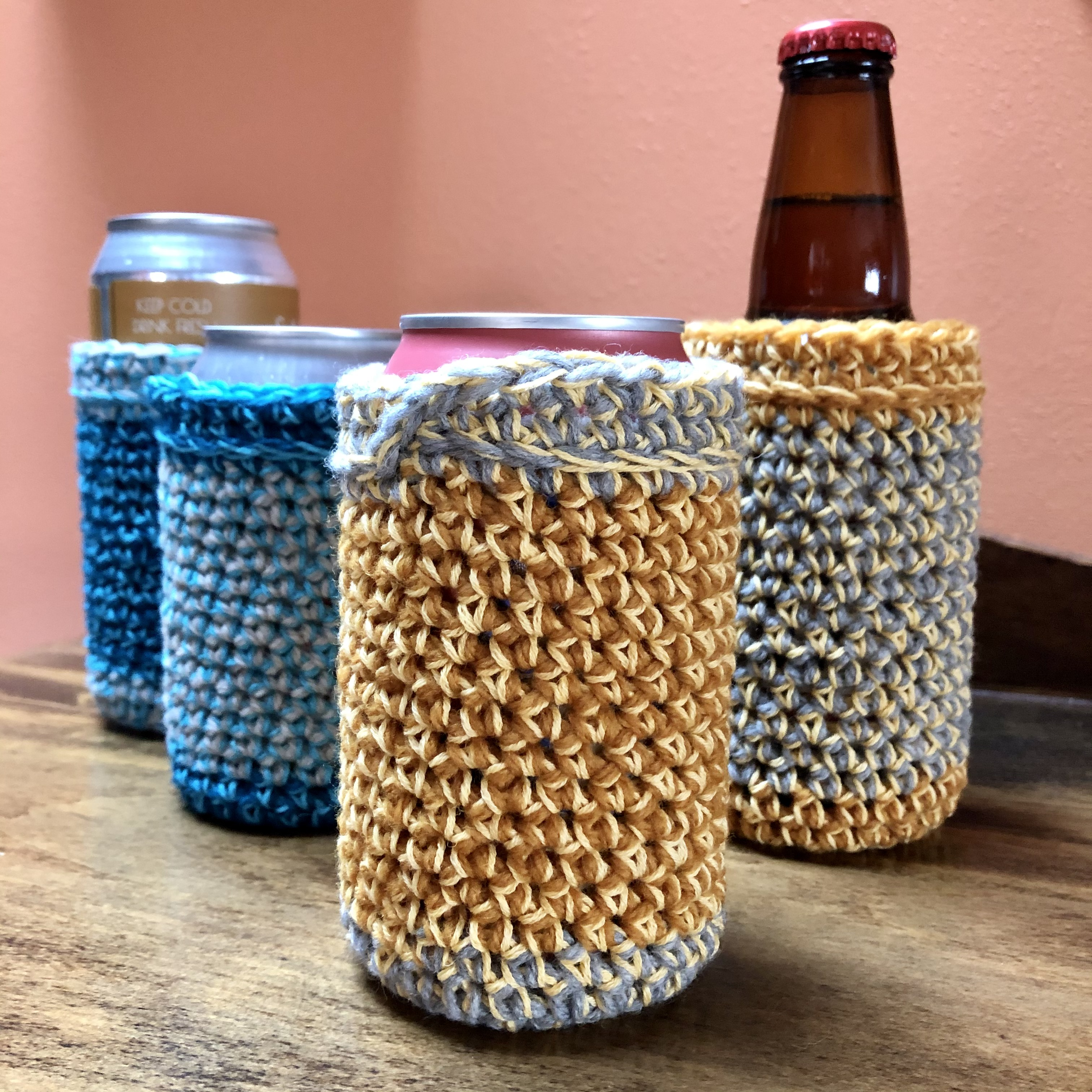 Four can/bottle koozies