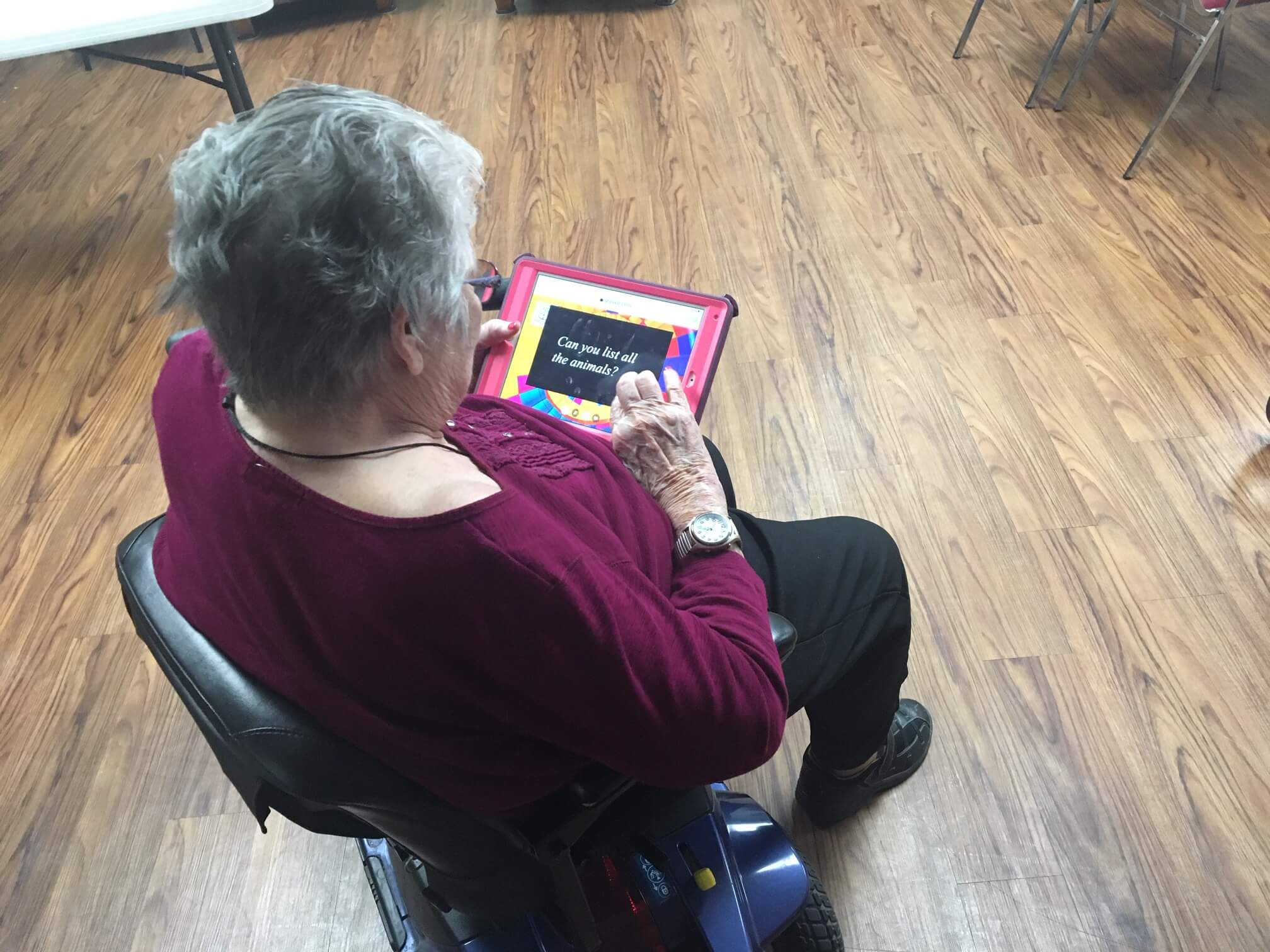 A senior playing brain games on Televeda