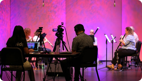 Group of musicians recoding their performance