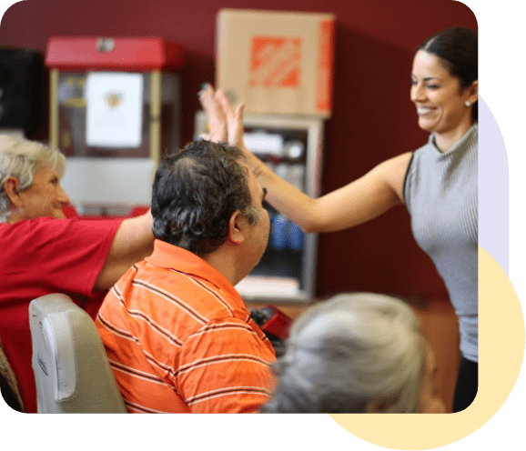 instructor and  senior citizen  giving high five