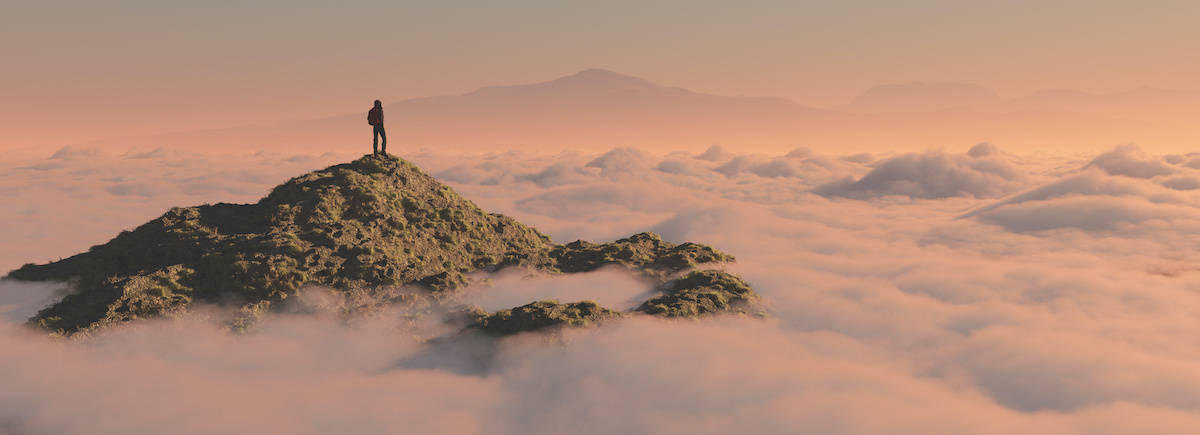 journey man on top of mountain overlooking clouds