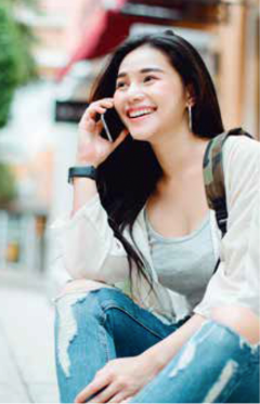 Smiling Person Holding Phone