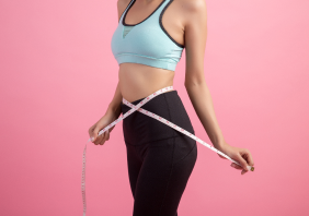 Health model measuring her waist