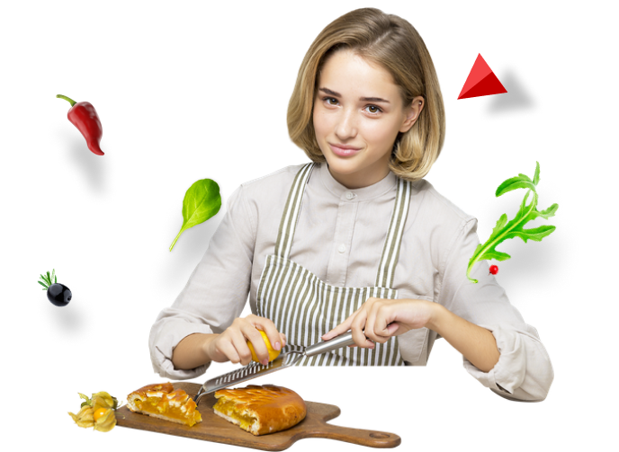 Woman wearing an apron slicing some cheese on a loaf of bread