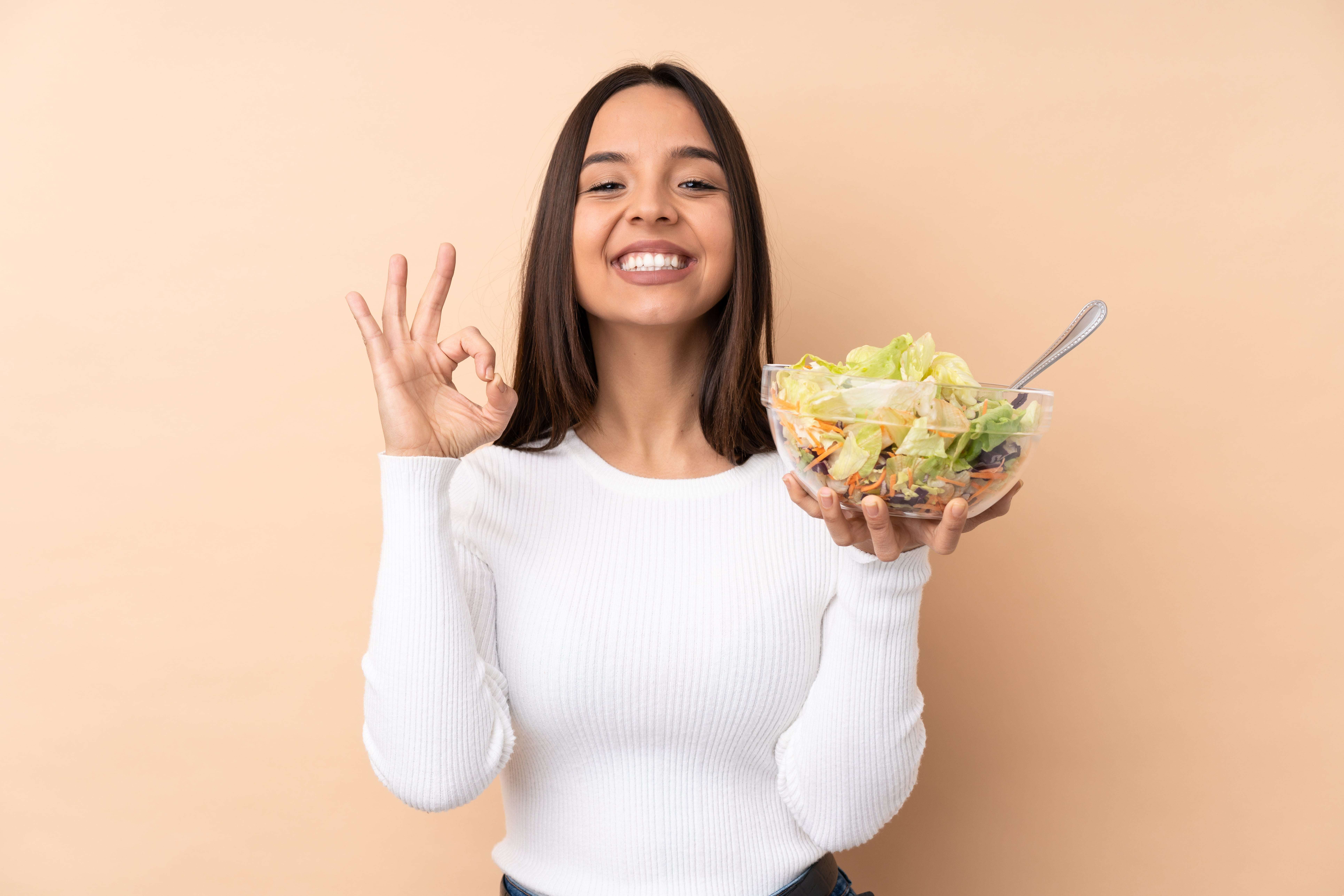 Woman showing appreciation to a bowl of salad
