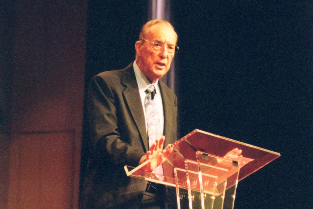 Derek Prince preaching a sermon at church