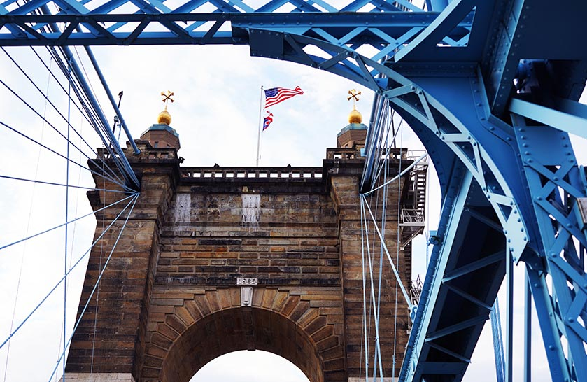 The John A. Roebling Bridge spans the Ohio River, connecting Northern Kentucky with Cincinnati, OH.