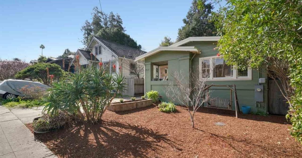 Exterior of green house with garden for sale in Oakland, California