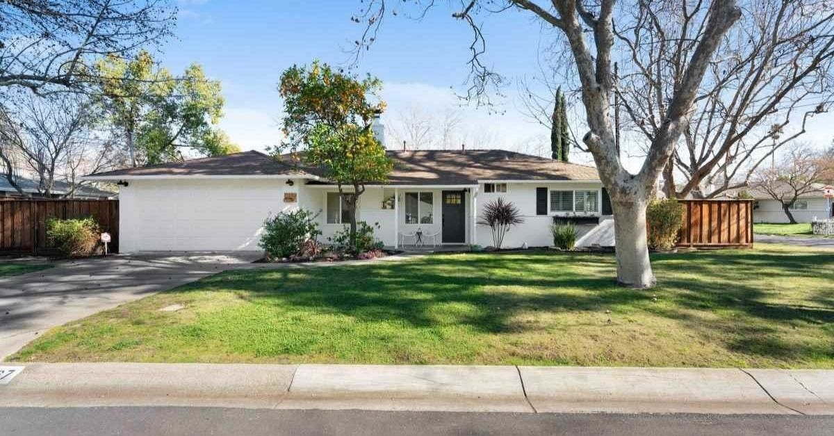 White Craftsman style home for sale in Pleasant Hill, California exterior shot with garage and garden