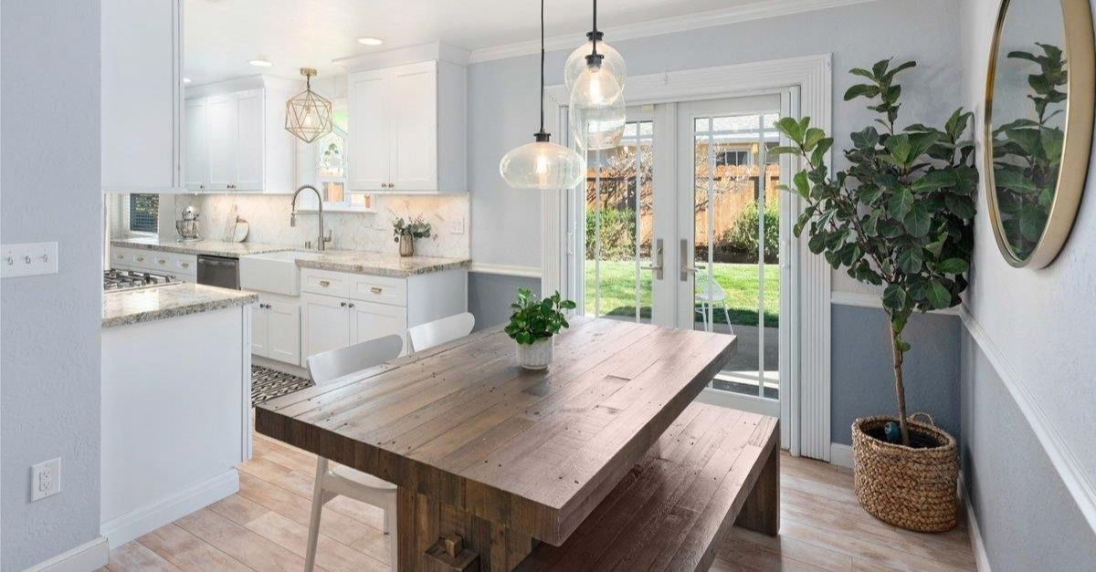 Interior of Craftsman style home in California with lovely kitchen and large dining table with bench