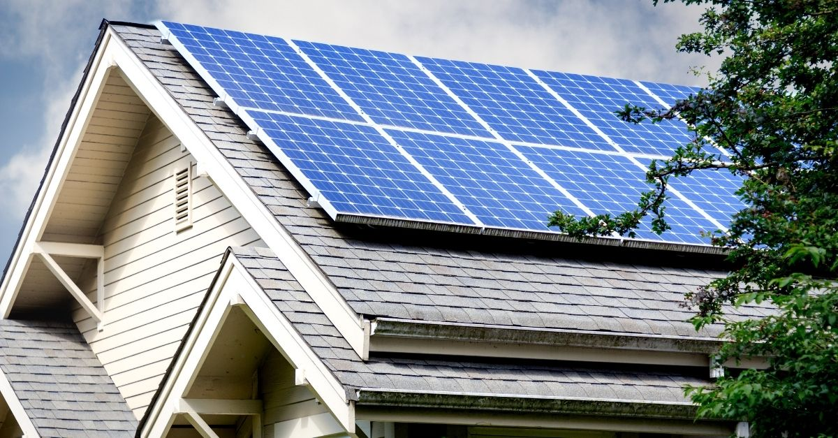 House roof with solar panels green home