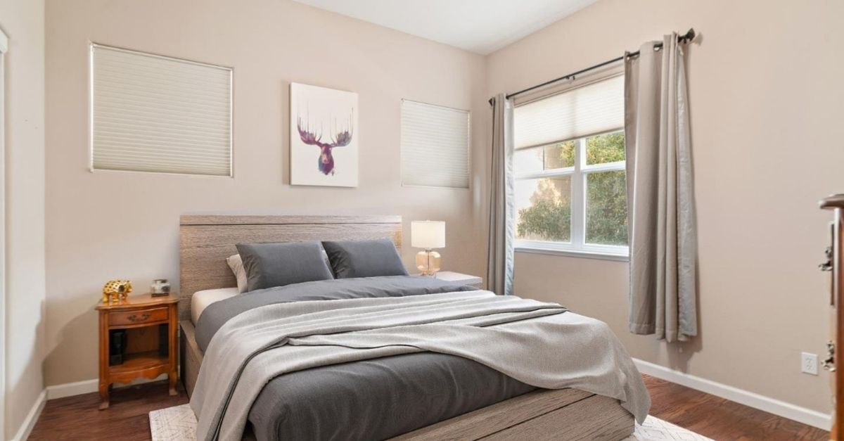 Bedroom with window and grey bedspread