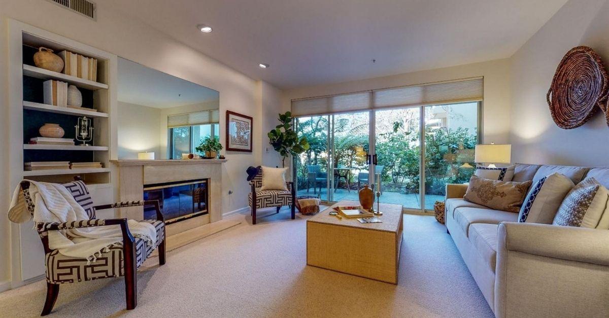 Garden level living room with sliding glass doors