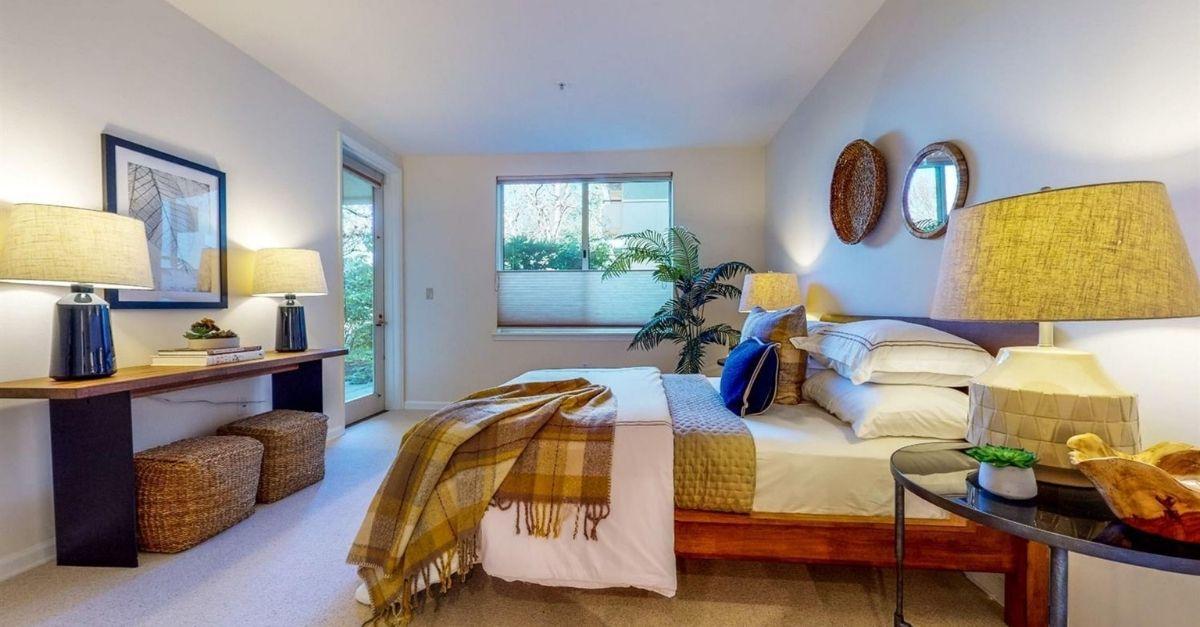 Cozy bedroom with glass door to garden