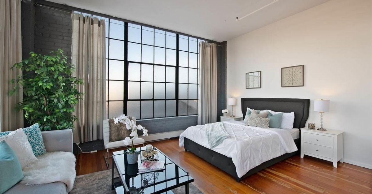 Bedroom with warehouse style windows