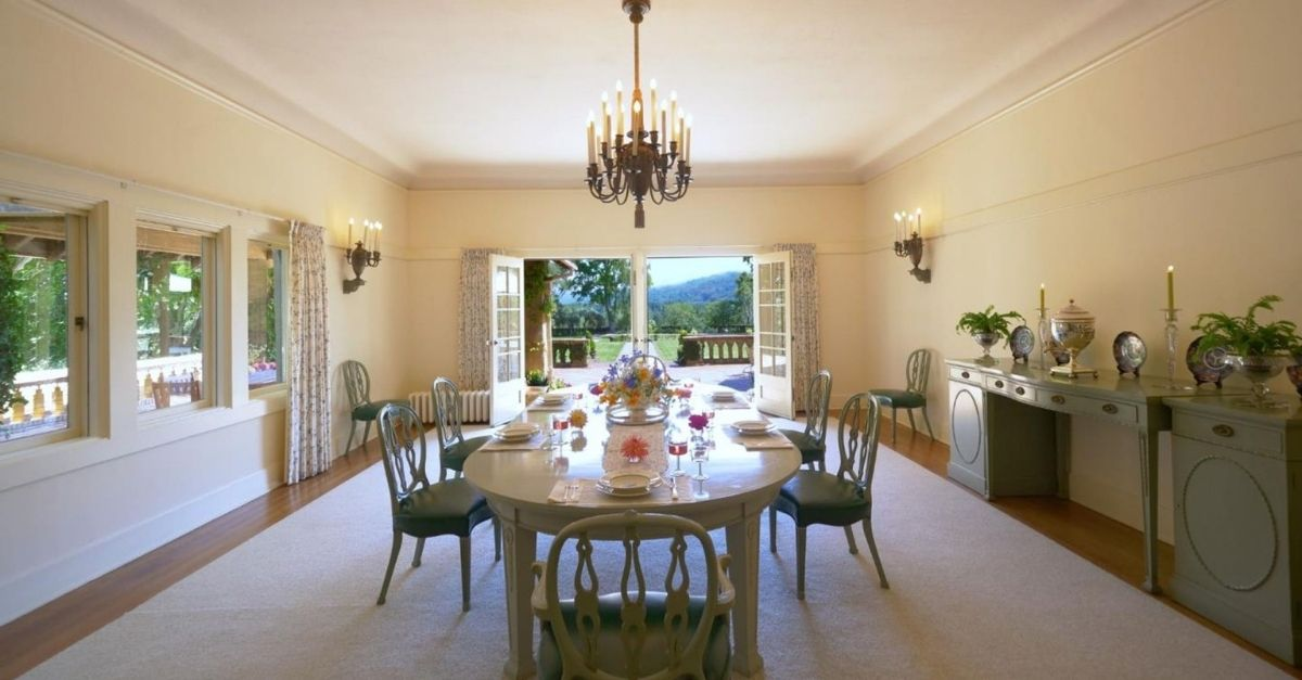Bright and open dining room with green furniture