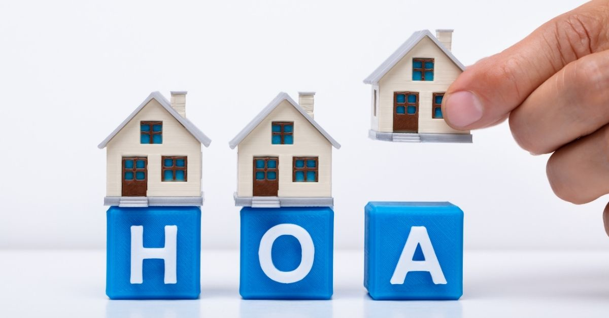 Image of little toy houses that say HOA under them