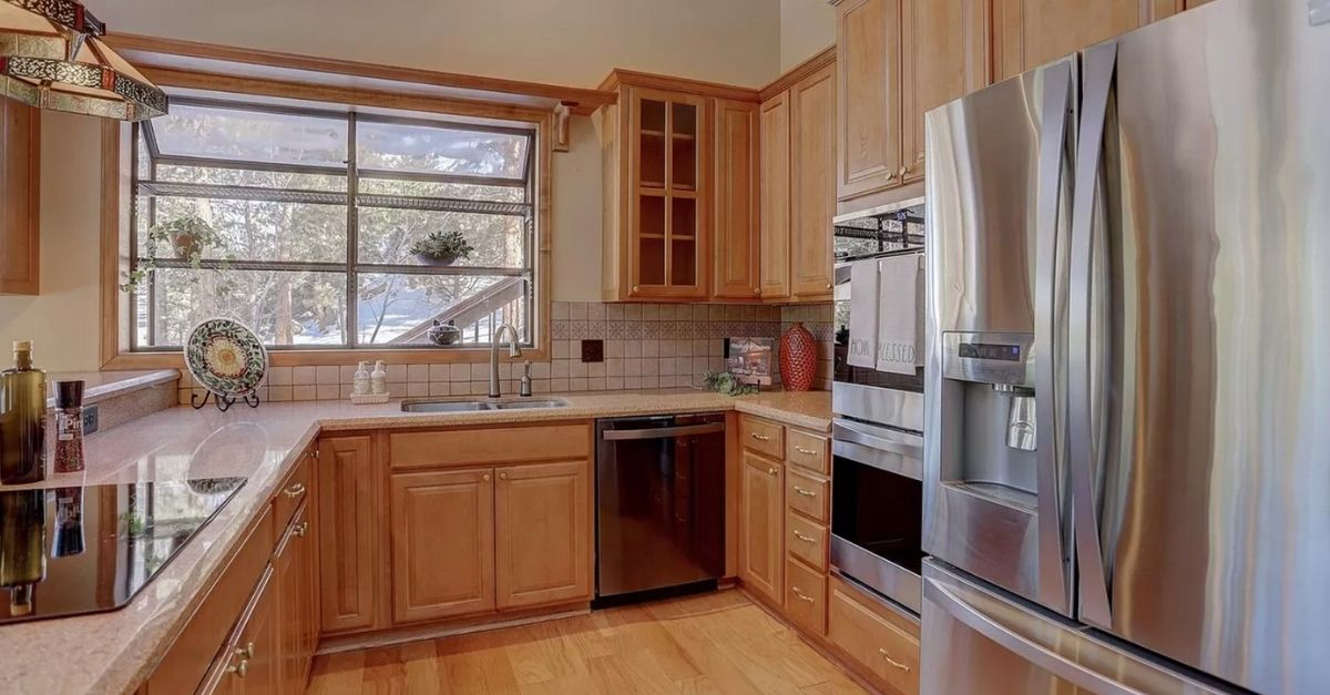 Light color wood kitchen with stainless steel appliances