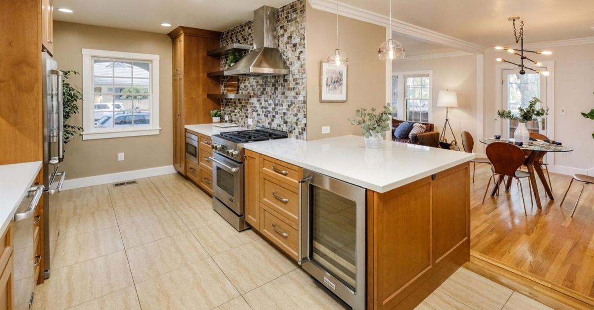 Remodeled kitchen wit wine fridge and quarts countertops
