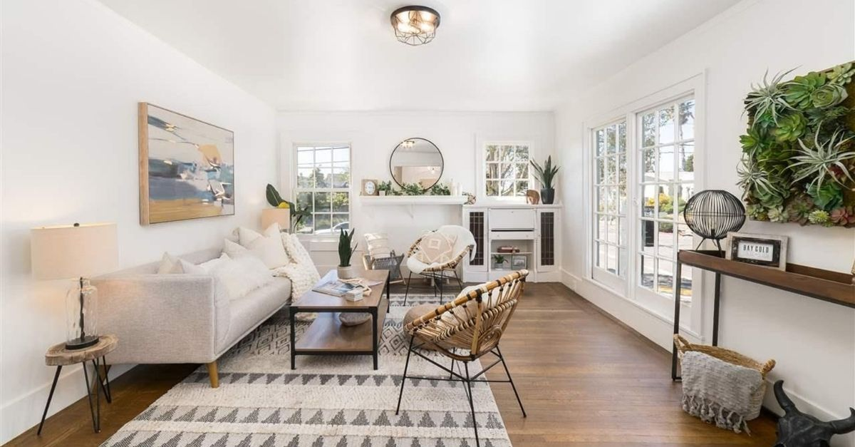 Bright, light and white living room with lots of natural life and plants