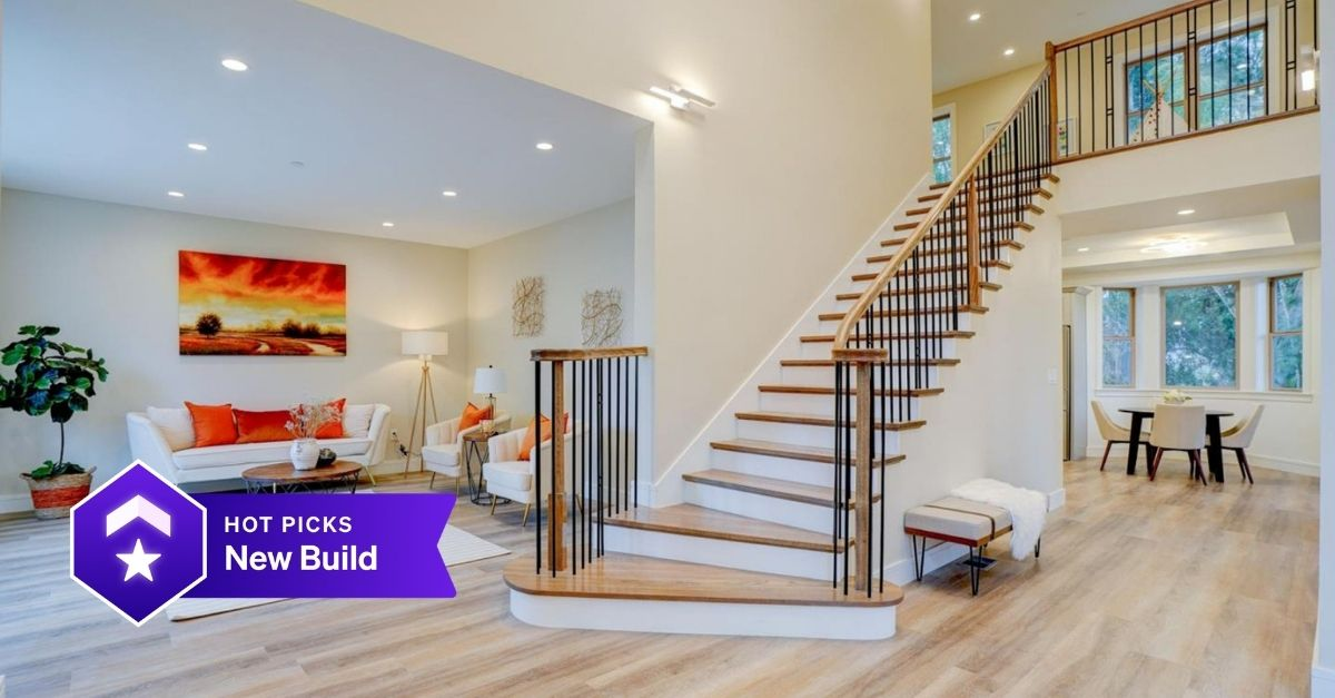 Beautiful stair case in open plan foyer and living room
