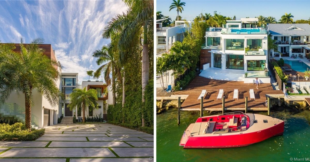 Modern white house with lots of gass on Miami waterfont with dock and red flashy speed boat