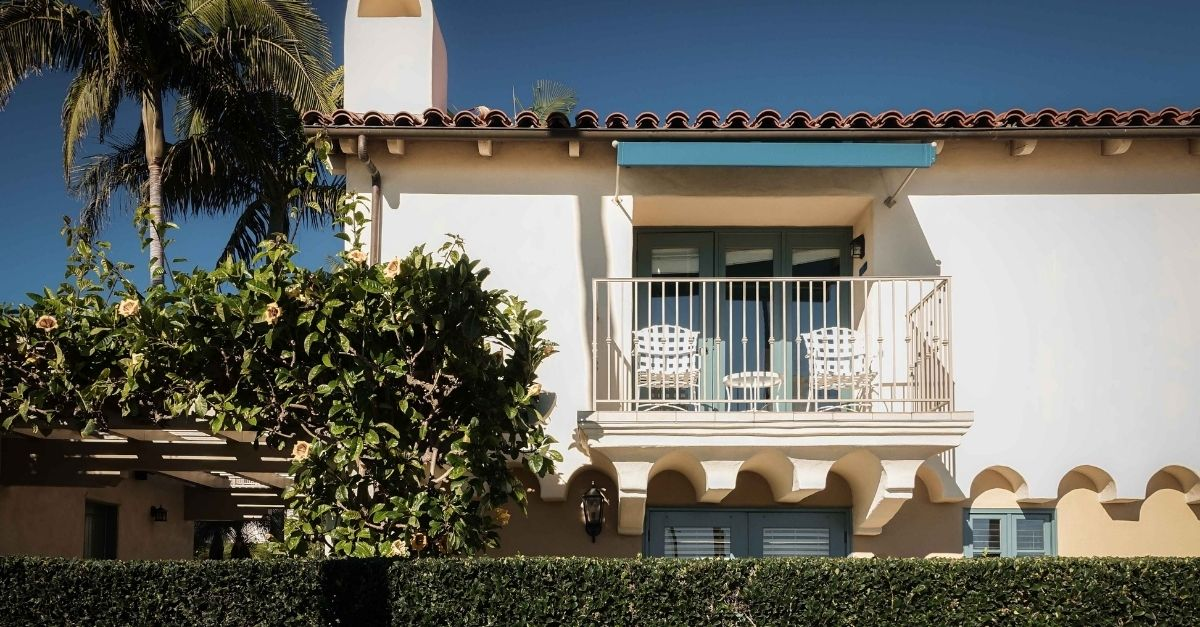 Mediterranean style house with terracotta roof tiles and balconies