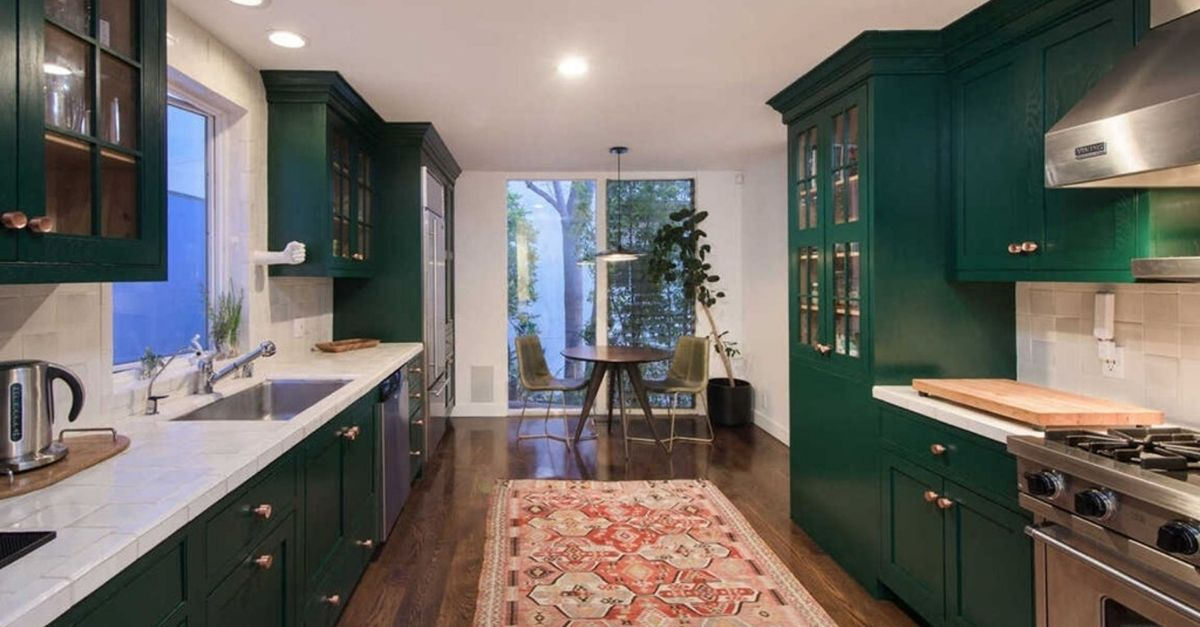 8450 Carlton Way in Los Angeles forest green kitchen with breakfast nook