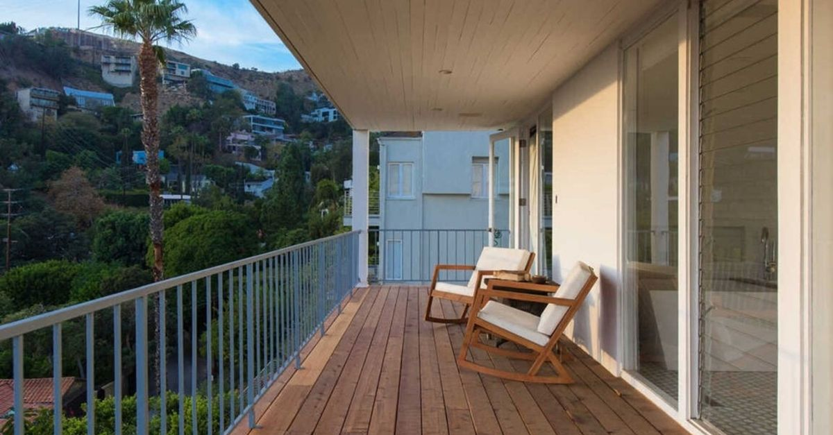 Deck with chairs and views of Los Angeles at 8450 Carlton Way in Los Angeles