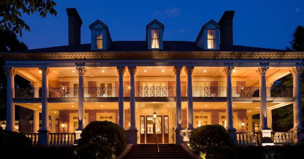 Beautiful Belle Meade, Nashville estate lit up at night.
