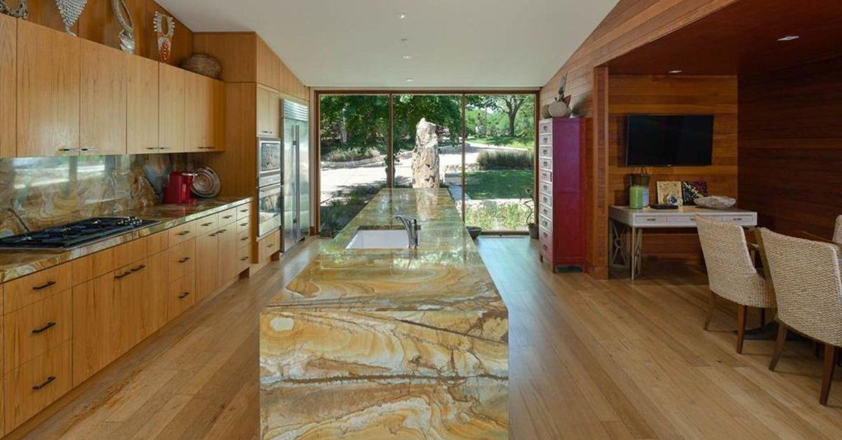 Incredible kitchen with brown onyx waterfall island