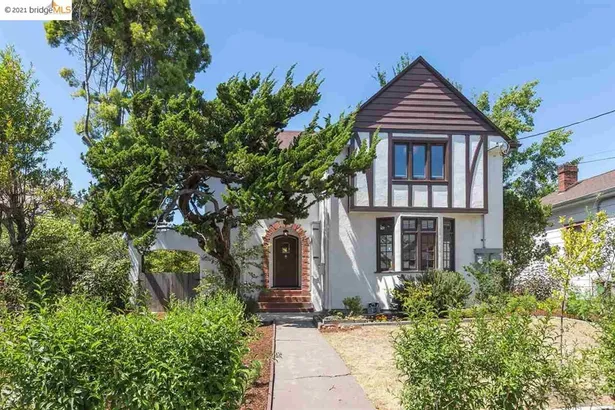 Exterior of a tudor style house with a front yard n Berkeley California
