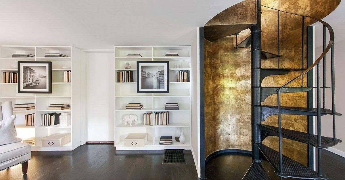 Styled shelves with gold leaf stairwell and spiral staircase
