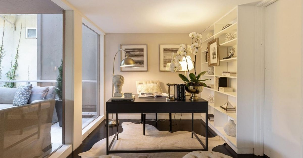 Beautiful office with black table and white stylings