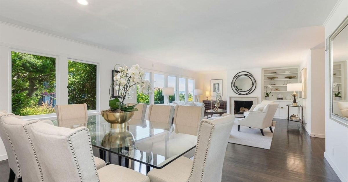 White living room and dining room with fireplace