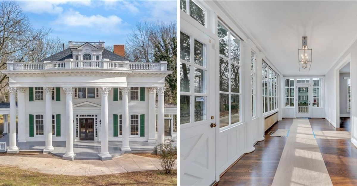 Huge white house with white columns and a large top floor balcony