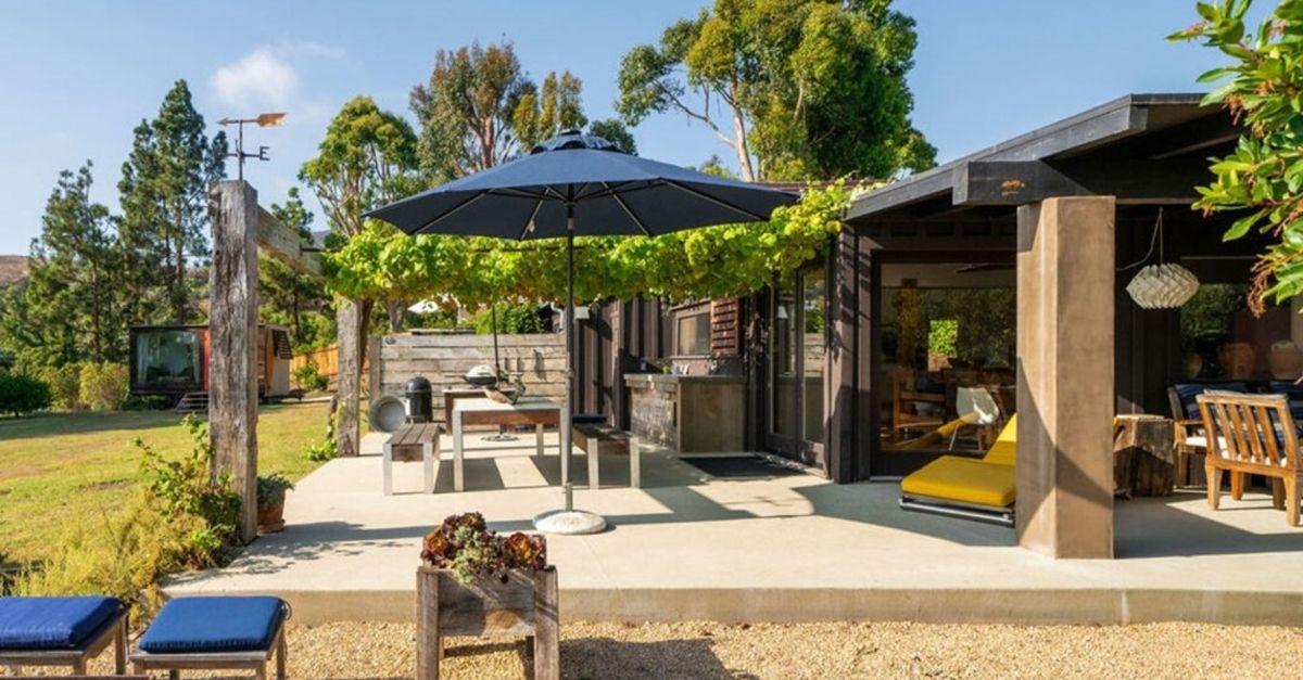 Fun outdoor area with seating and al fresco kitchen in Malibu