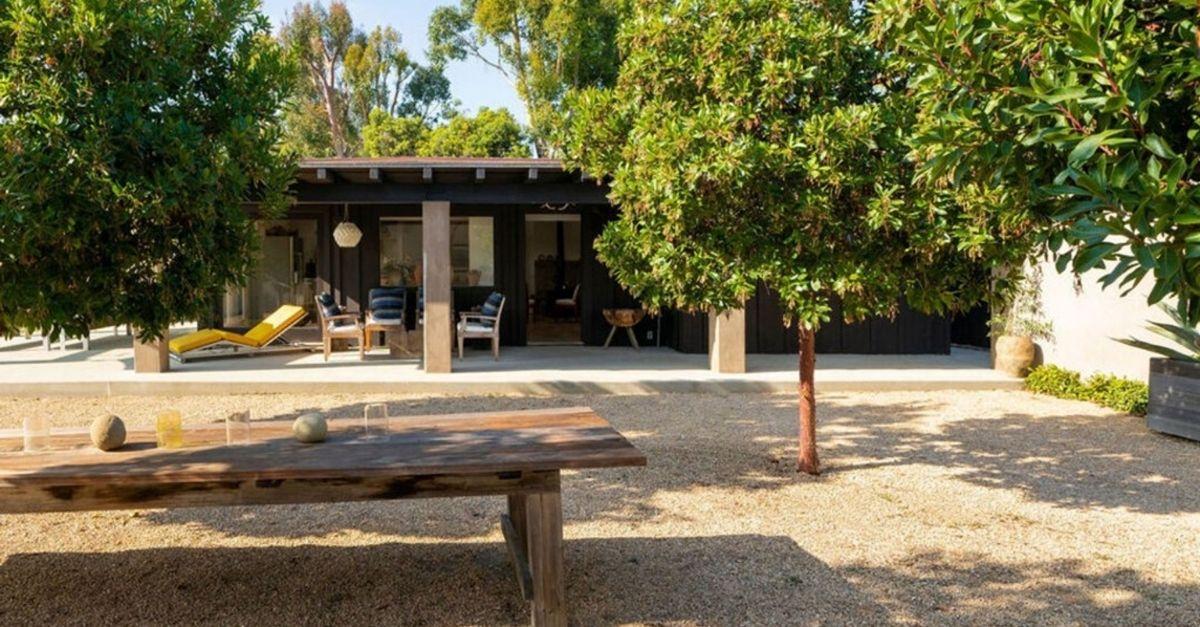 Long wood table outside house for sale