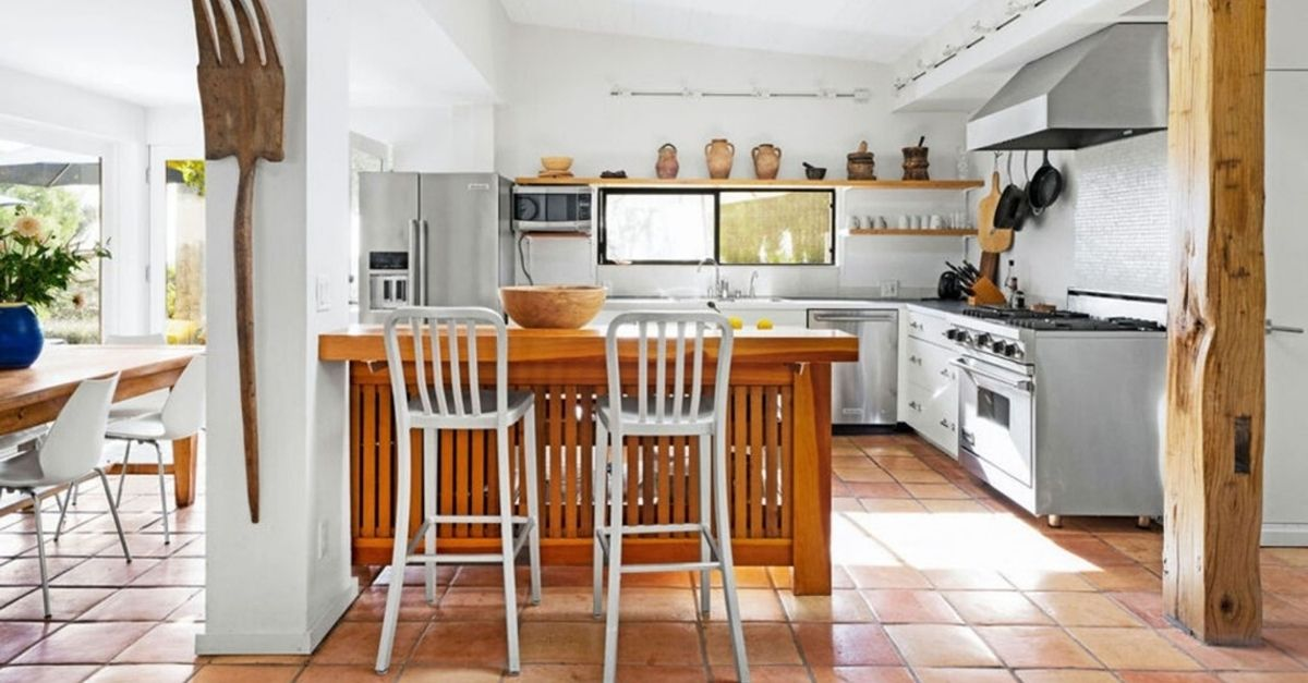 Beautiful kitchen with wood island and stainless steel stove