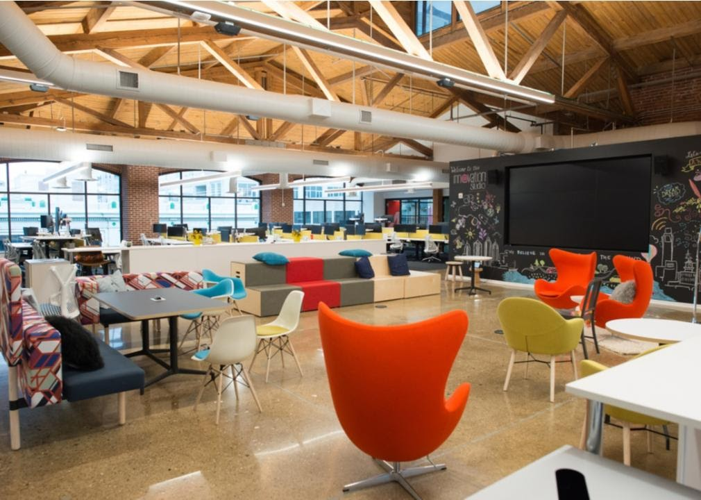 Open coworking office space with wood beam ceiling