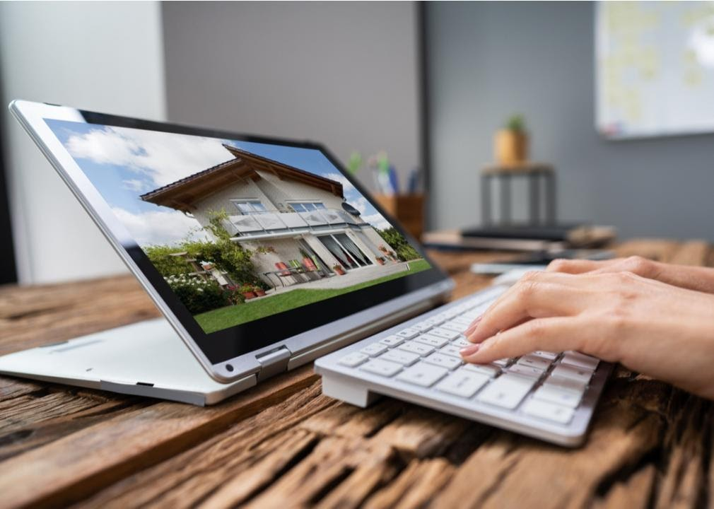 Tablet computer screen with house on screen