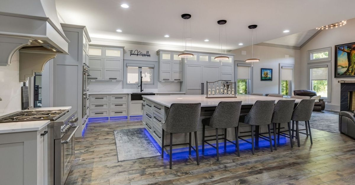 White and grey kitchen with white marble counters