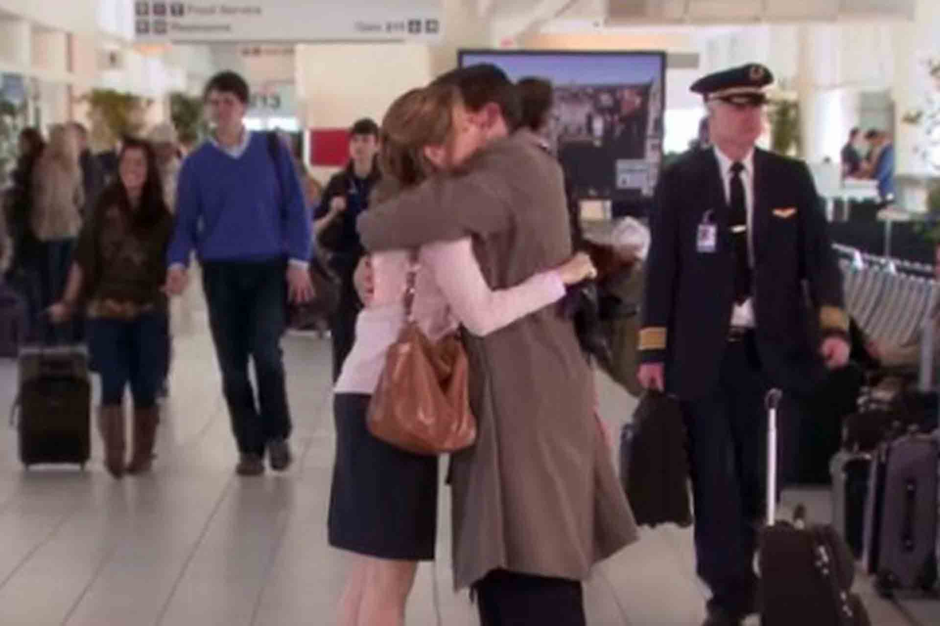 Pam hugs Michael at the airport before he leaves.